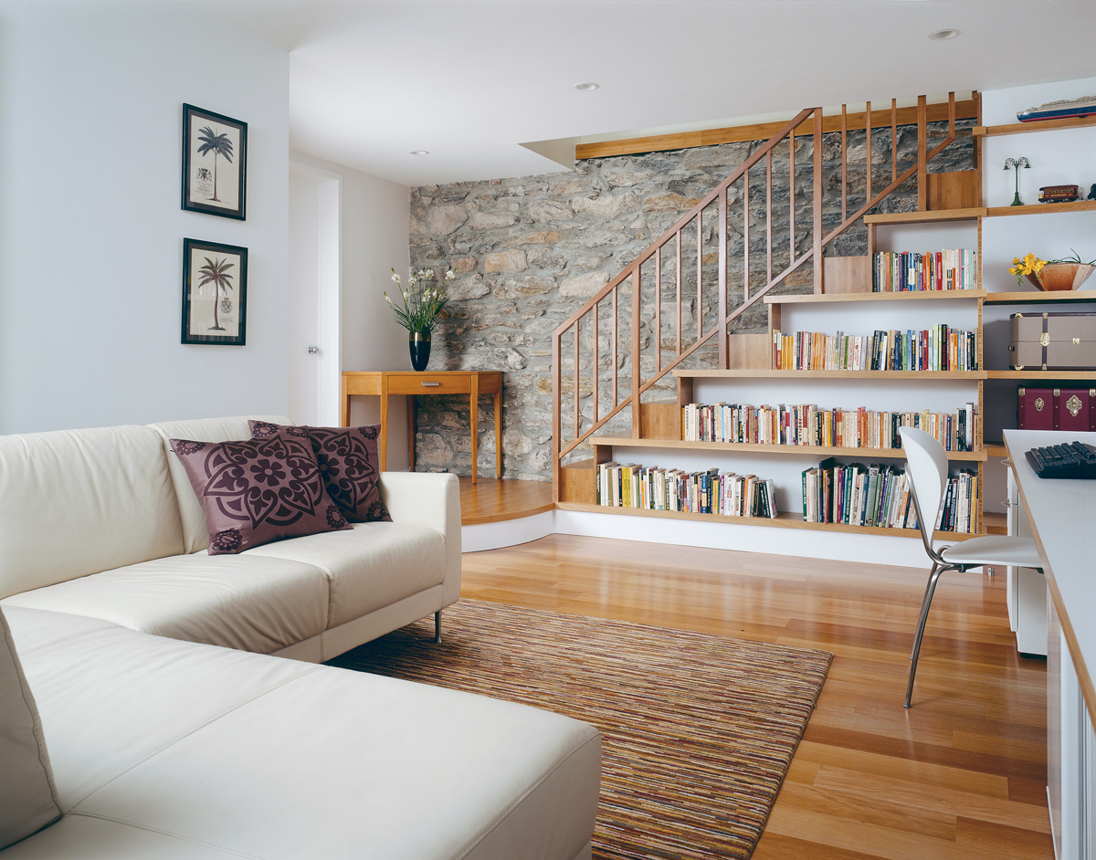 steps morph into bookshelves in park slope triplex