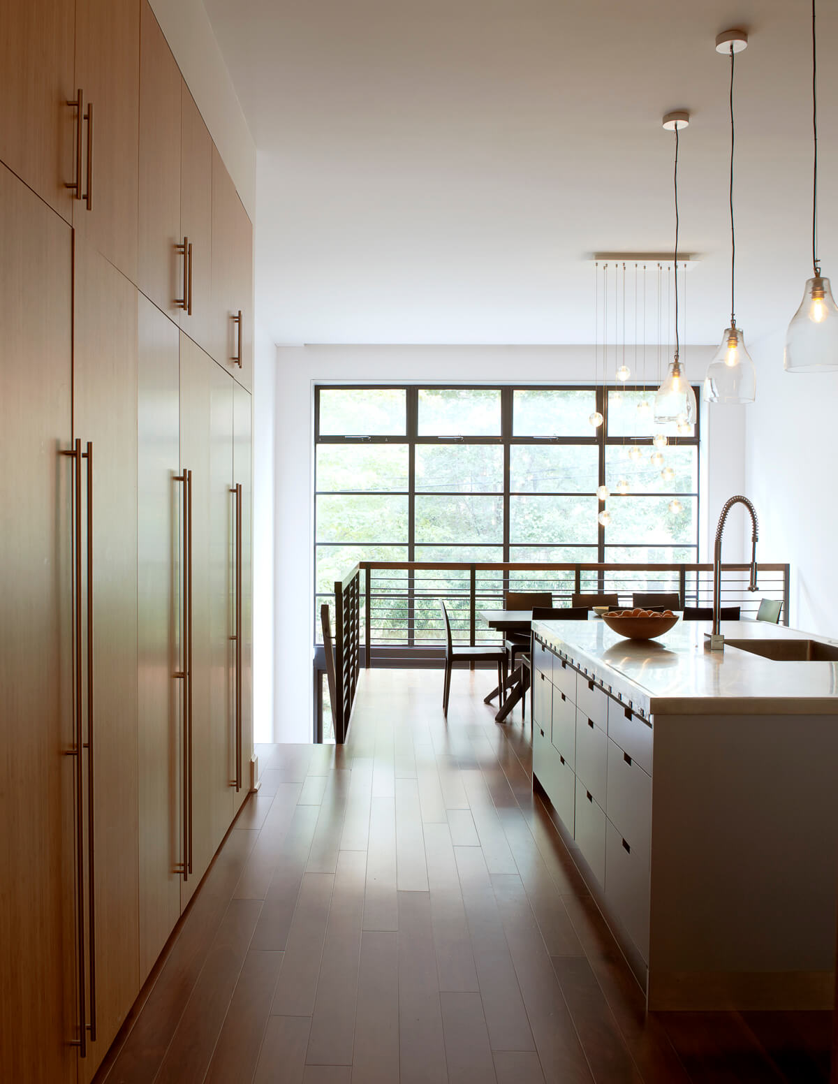 minimalist wall of bamboo cabinetry and new steel windows in Brooklyn Heights kitchen