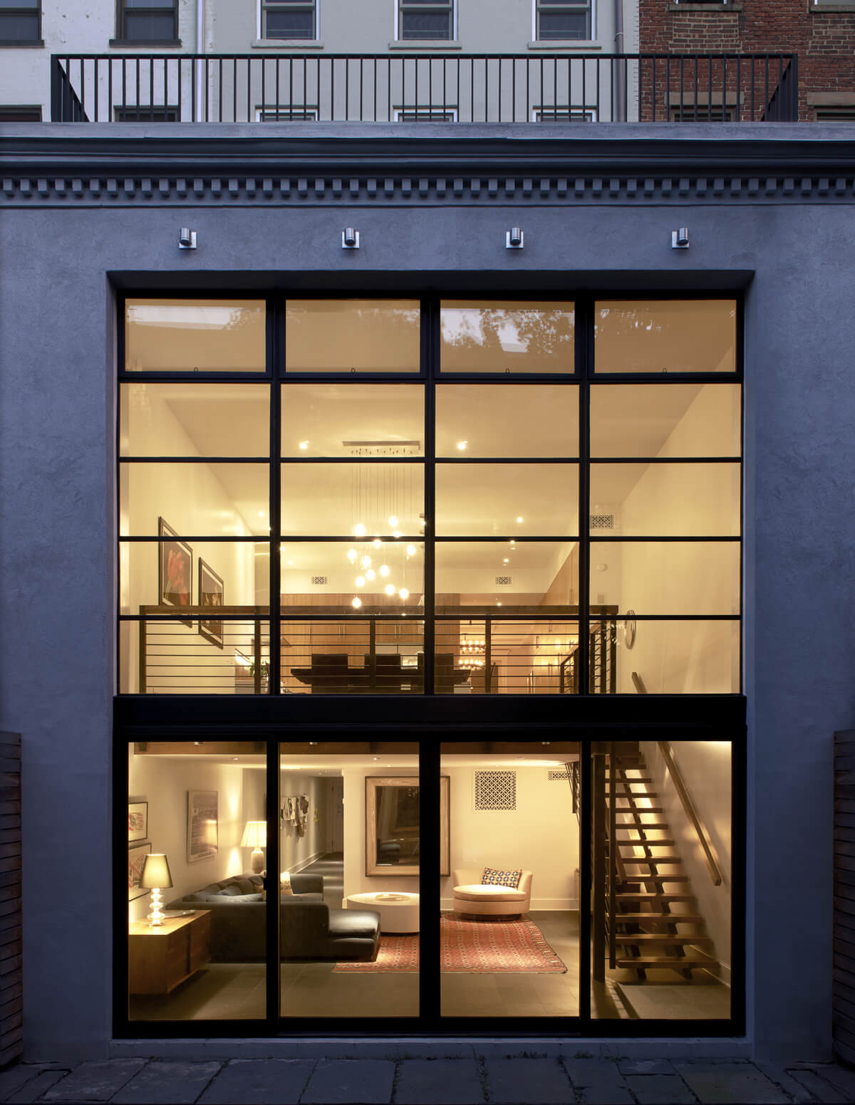 double-height wall of glass in large brownstone addition