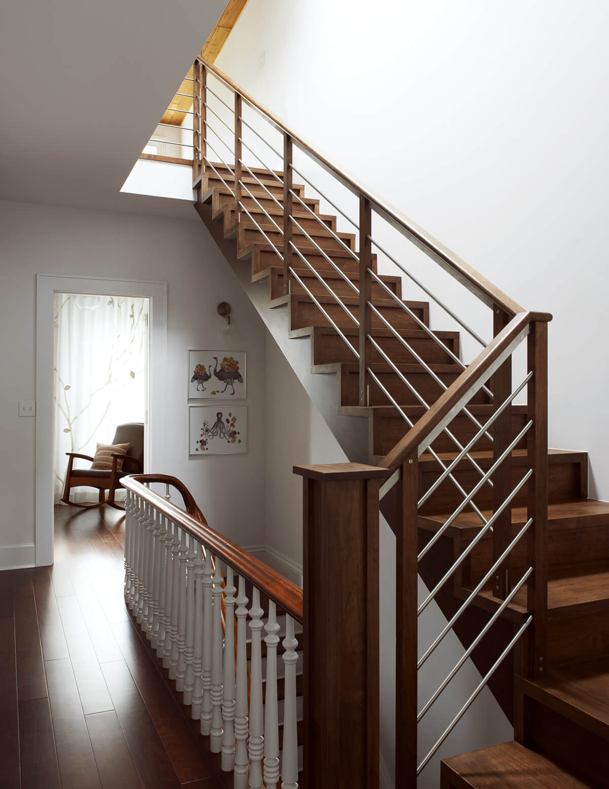 modern stair meets restored period stair in large brownstone addition