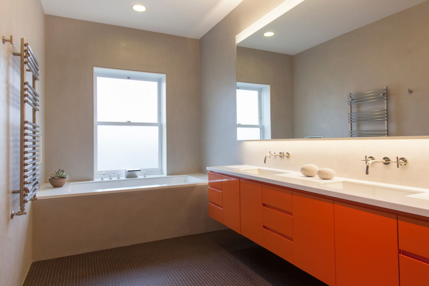Bathroom lighting integrated into vanity mirror