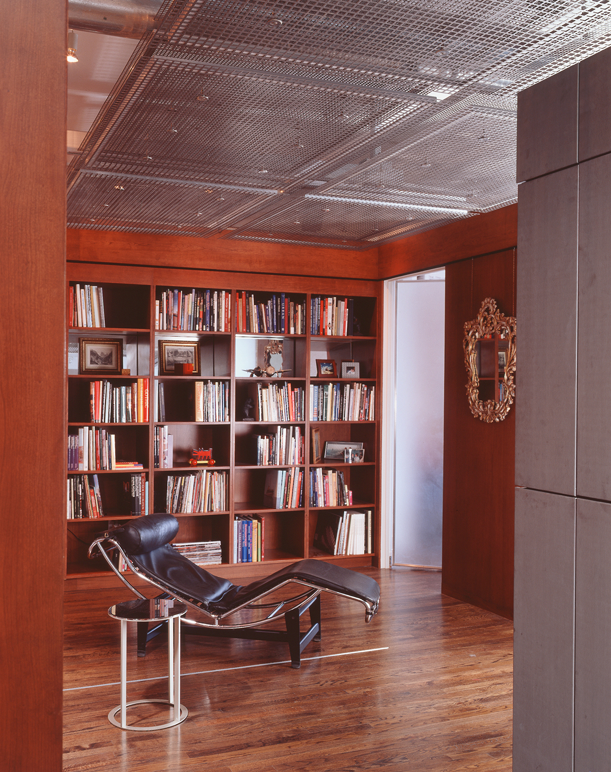 pivoting bookcase conceals murphy bed in chelsea penthouse library