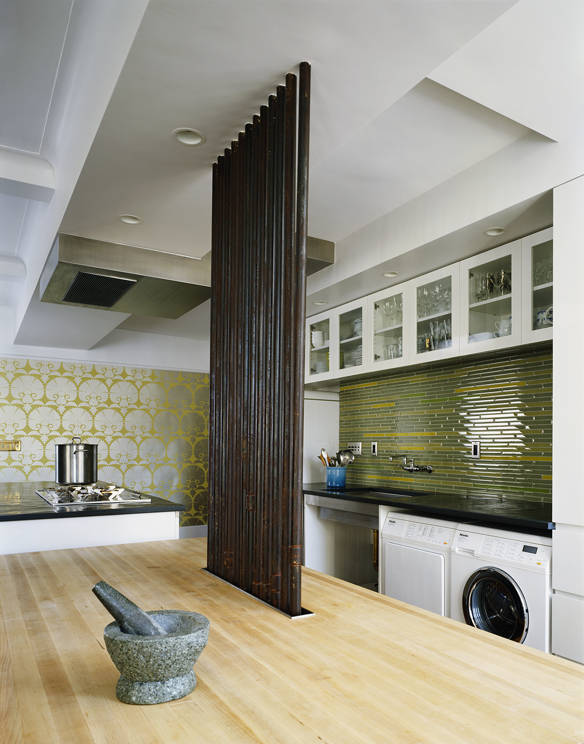 architects exposed the pipes at kitchen island
