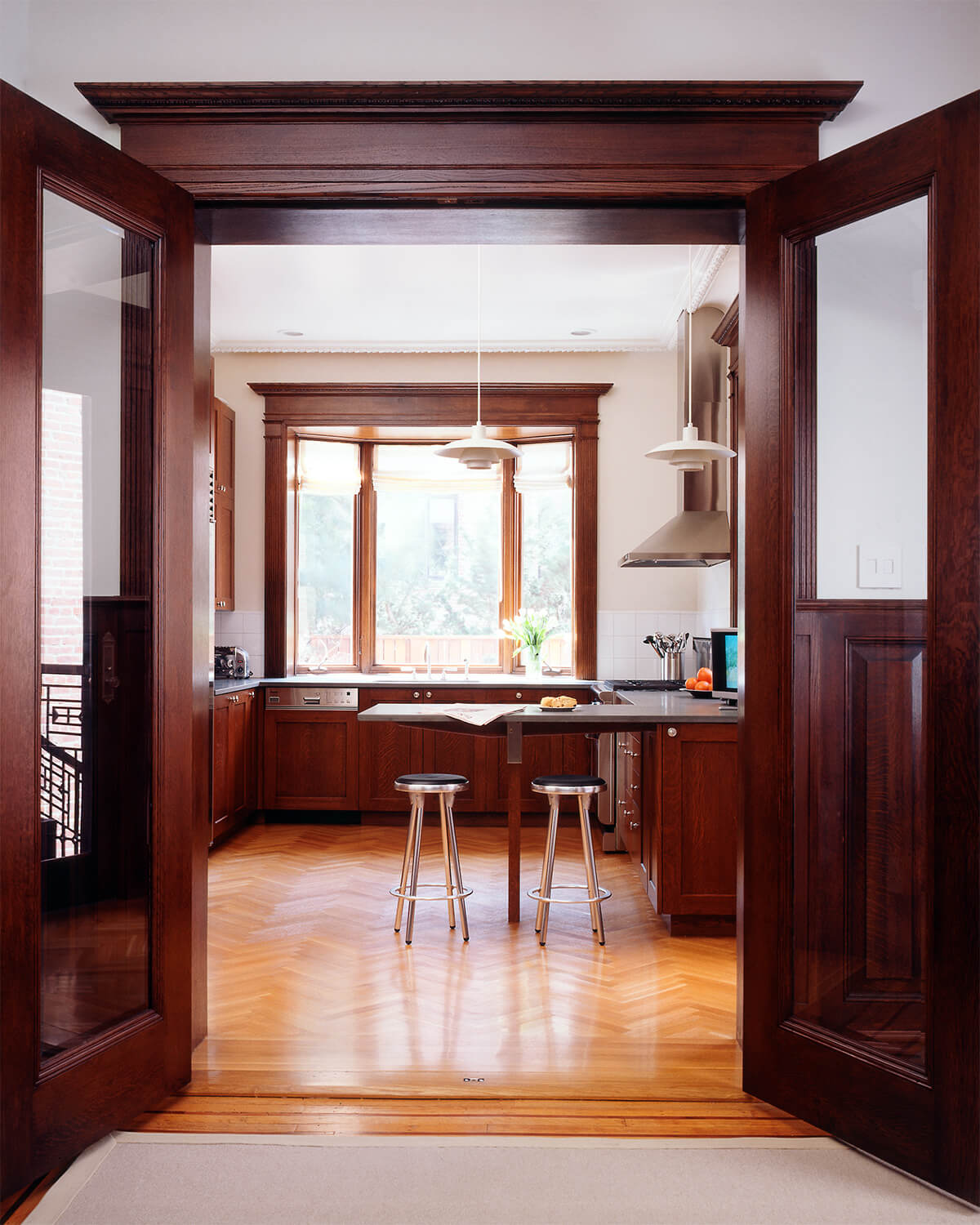 bay window in kitchen with replicated traditional mahogany and fluted-glass french doors
