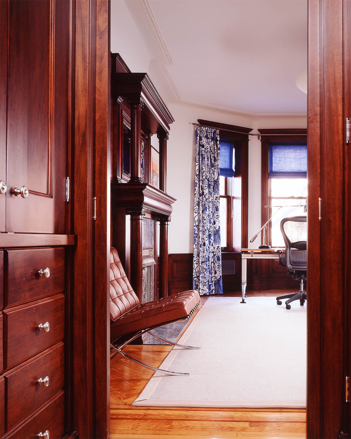 Replicated mahogany and oak millwork in grand limestone row house.