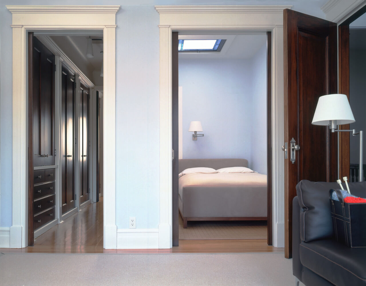 A new skylights turns an interior space into a bedroom in this grand limestone row house.