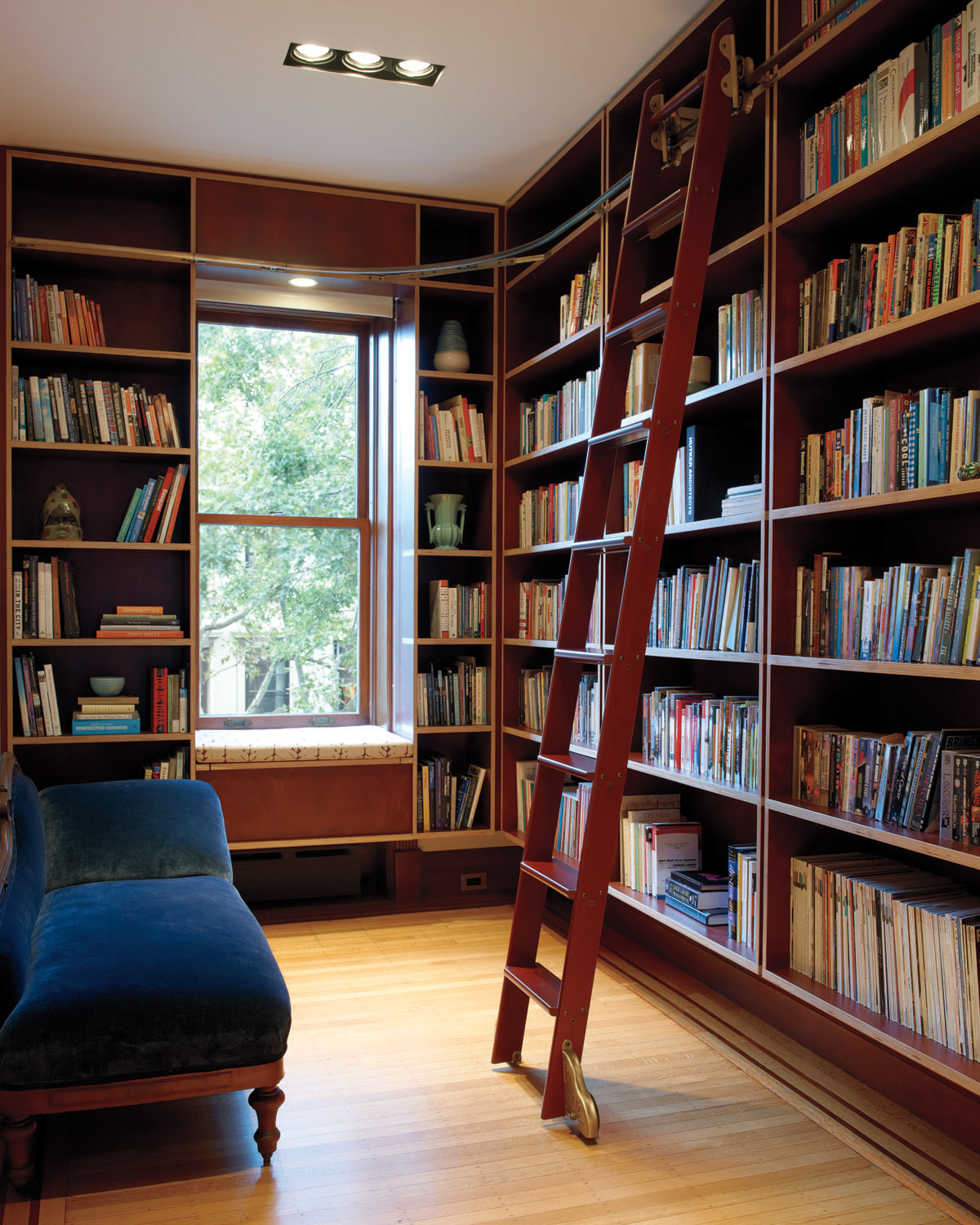 Brooklyn architects carefully restored park slope townhouse with a library of built-in book shelves and rolling ladder