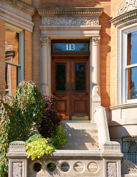 Restored entry door and stoop at Prospect Park West house.