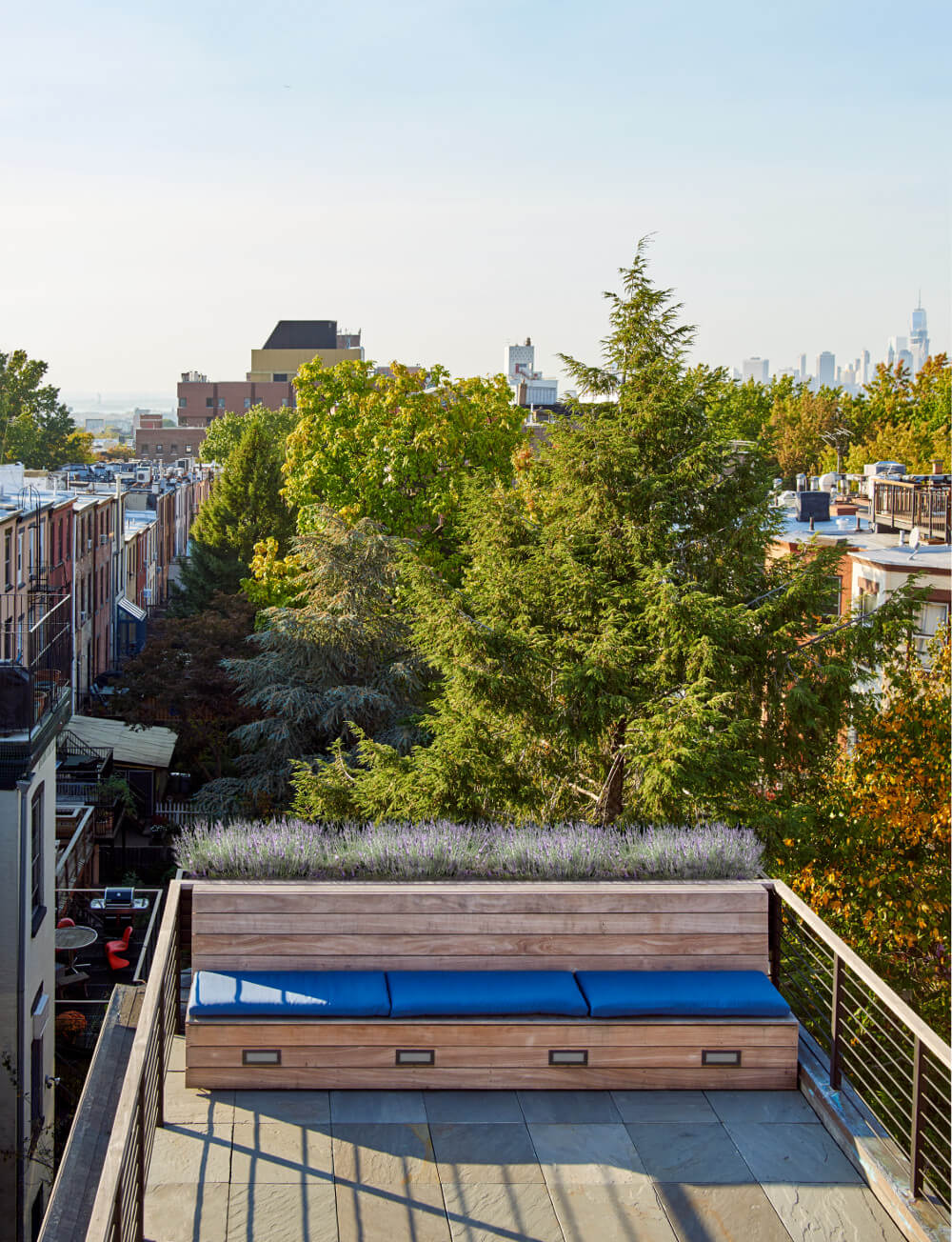 The bluestone roof deck has an ipe storage bench with built-in planter.