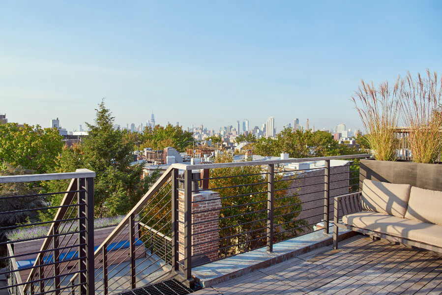 At the top of the Prospect Park West house, a new outdoor stair connects two new bluestone roof decks.