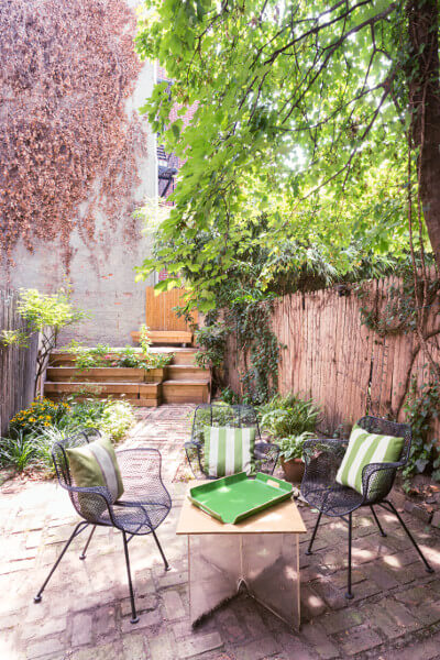 garden with brick pavers and terraced beds for this quirky apartment