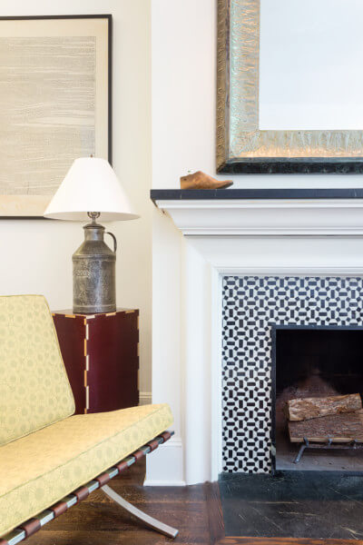 restored tile and soapstone fireplace in quirky apartment