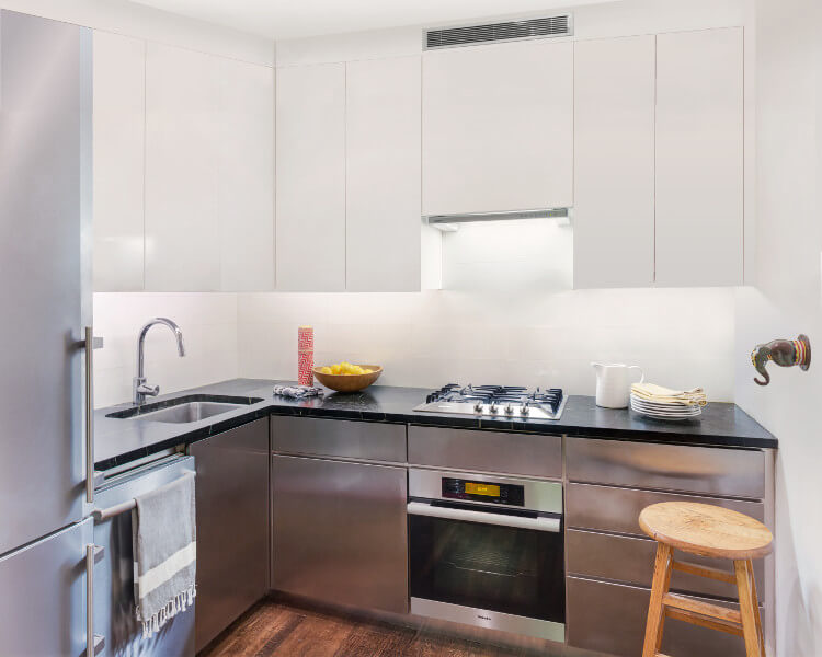 tiny kitchen in quirky apartment by Delson or Sherman Architects