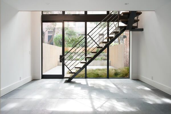 A view to the garden through steel windows and stair