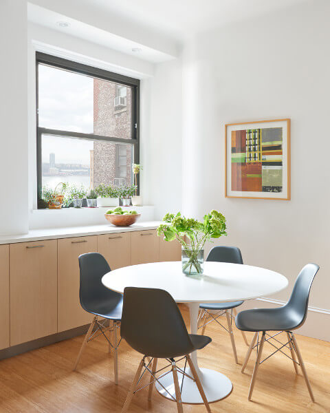 The breakfast room in this West End Avenue Apartment takes advantage of a neglected view of the Hudson River.