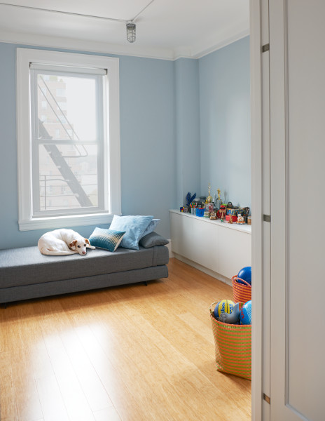 Bamboo flooring and blue gray walls make a handsome playroom in this West End Avenue apartment.
