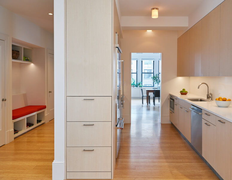 Back-to-back kitchen and foyer in this West End Avenue apartment.