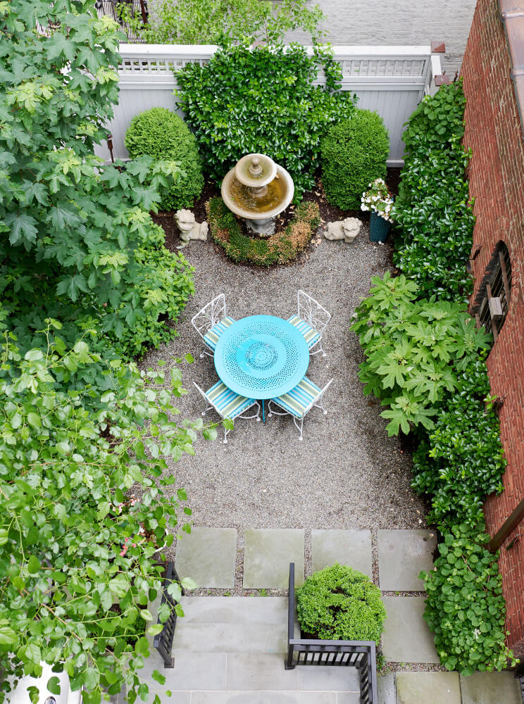 A bird's-eye view of the verdant backyard of this Prospect Park West twin house, set up for outdoor dining.