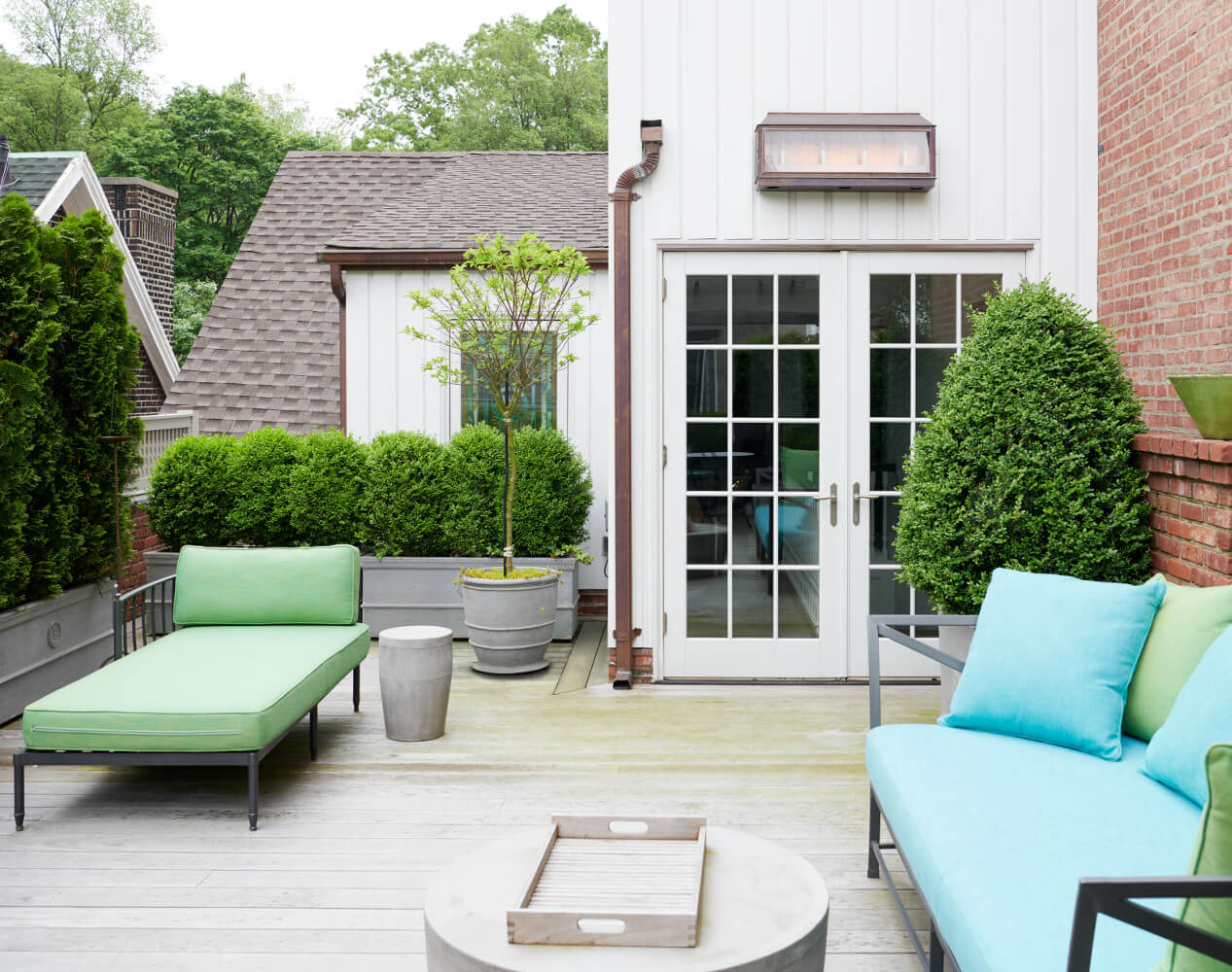 The small rooftop addition for this Prospect Park West twin house conceals air conditioning equipment while creating a graceful passage to a lushly planted roof deck.