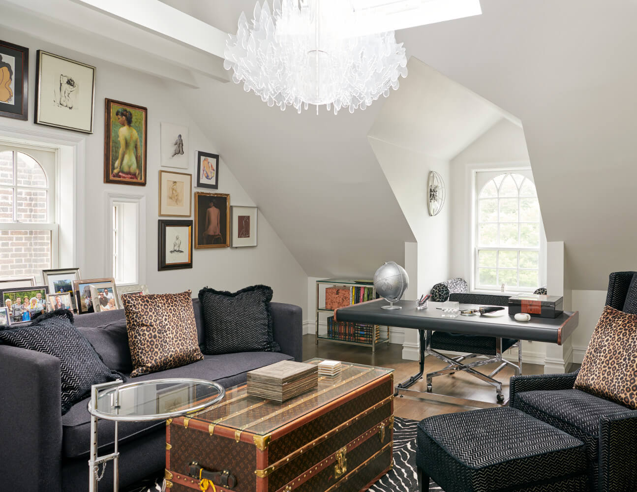 The top floor of this Prospect Park West twin house is a sitting room with a dormered window, exposed beams, and a wall of nude backs.