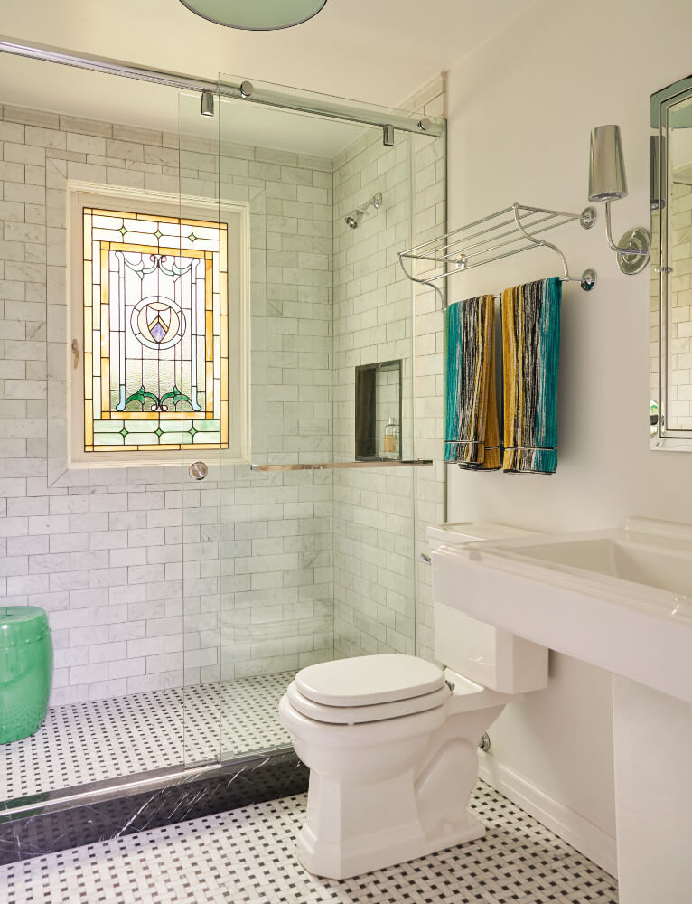 The guest bathroom of this Prospect Park West twin house has a salvaged stained-glass window and a walk-in shower. Another fine renovation by Delson or Sherman Architects.