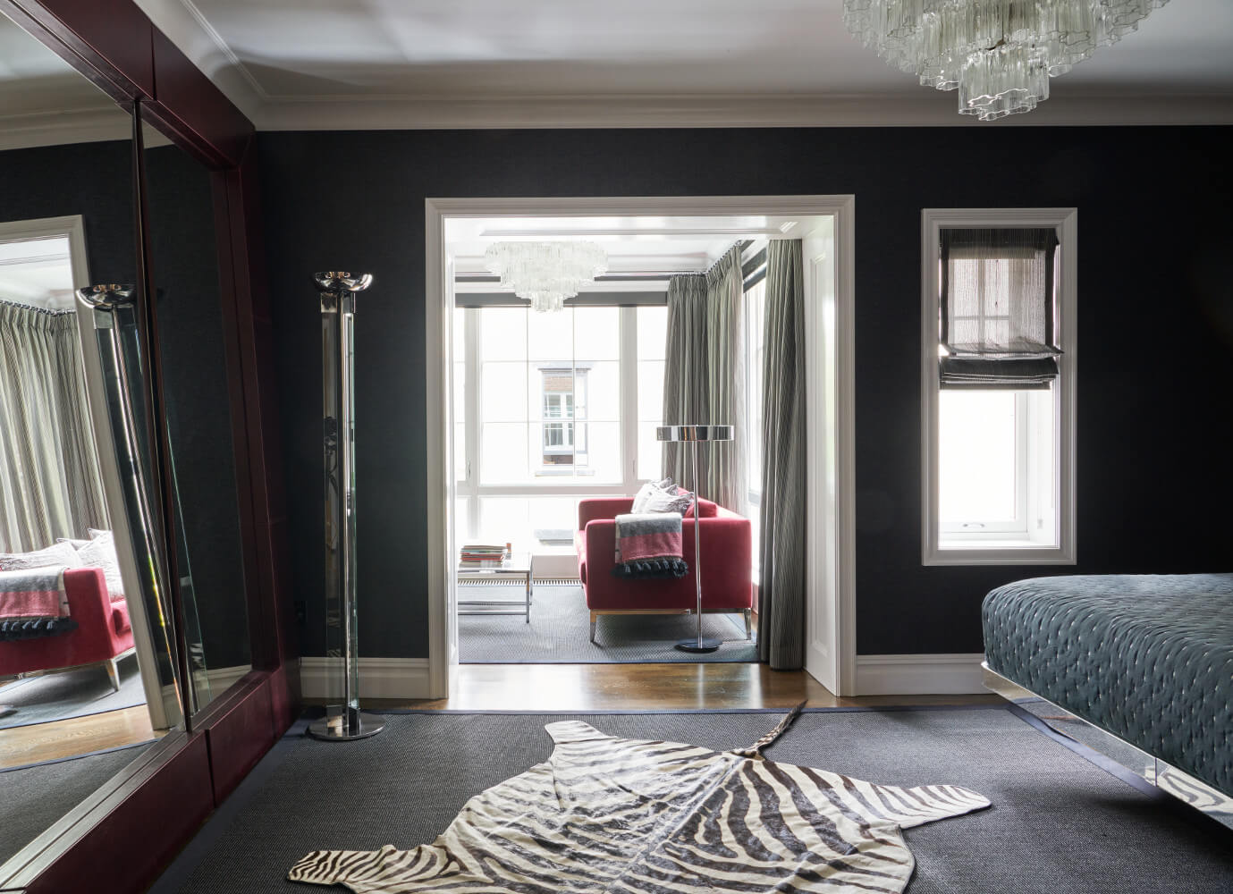 The black-painted master bedroom of this Prospect Park West twin house has its own sunny lounge space.