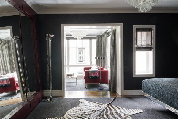 The black-painted master suite of this Prospect Park West twin house gets a big dose of sunlight through new French doors.