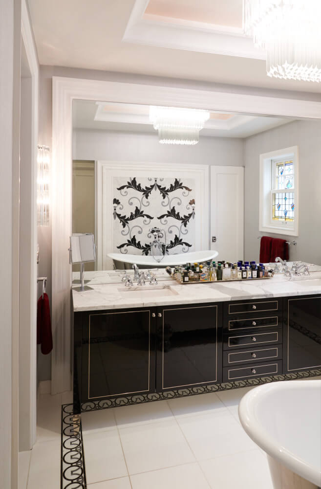 The master bathroom of this Prospect Park West twin house has a framed vanity, a clawfoot tub, and separate chambers for the toilet and walk-in shower.