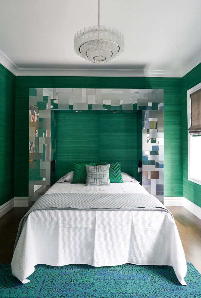 The green guest bedroom of this Prospect Park West twin house has a mirrored chrome proscenium for a headboard.