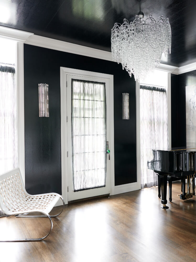 Black snakeskin wallpaper covers the foyer walls and ceiling of a Prospect Park West twin house.
