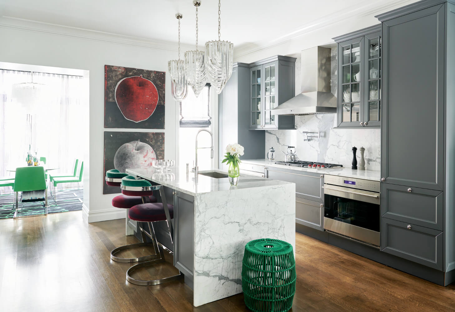 The kitchen of this Prospect Park West twin house has a statuary marble backsplash and matching countertops with waterfall edges.