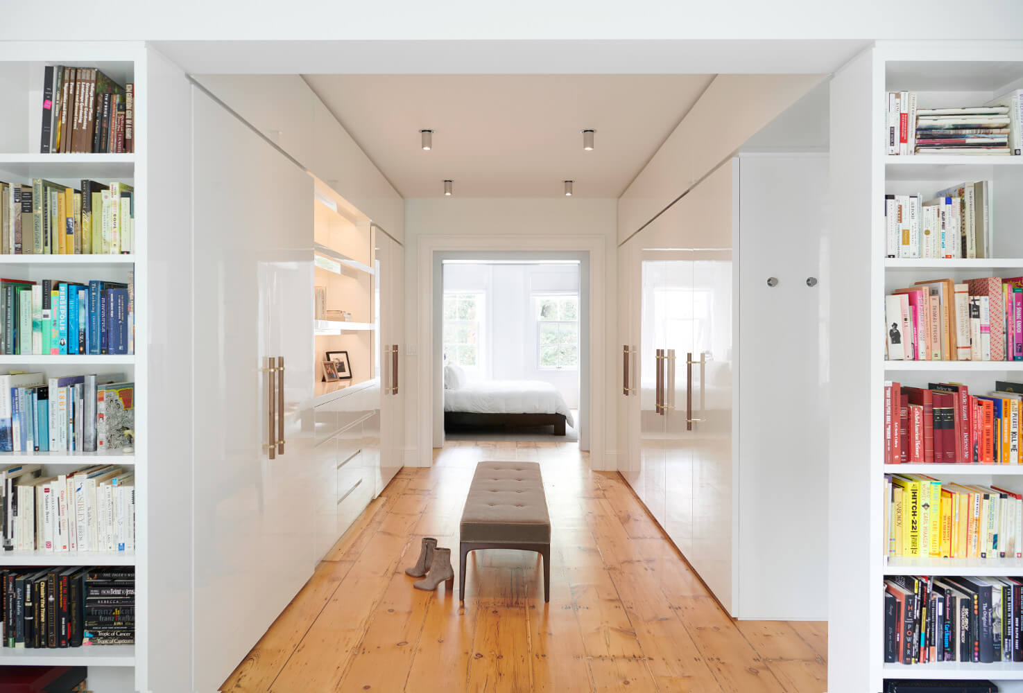 The master suite revolves around an oversized dressing room in minimalist high-gloss white.