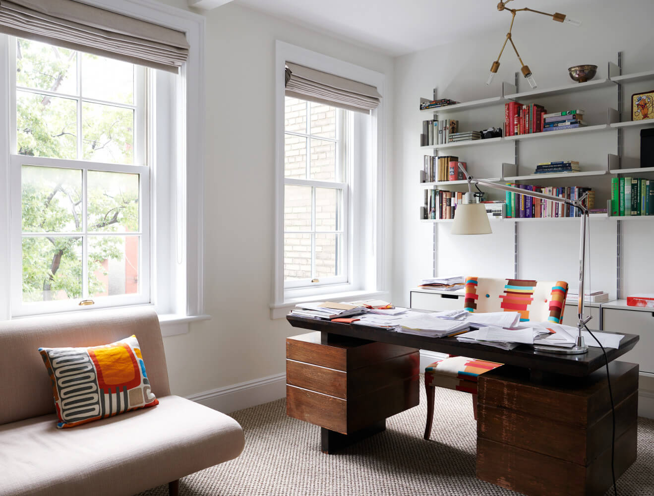 The home office features Vitsoe shelving and a Lindsey Adelman chandelier. Another fine renovation by Delson or Sherman Architects.