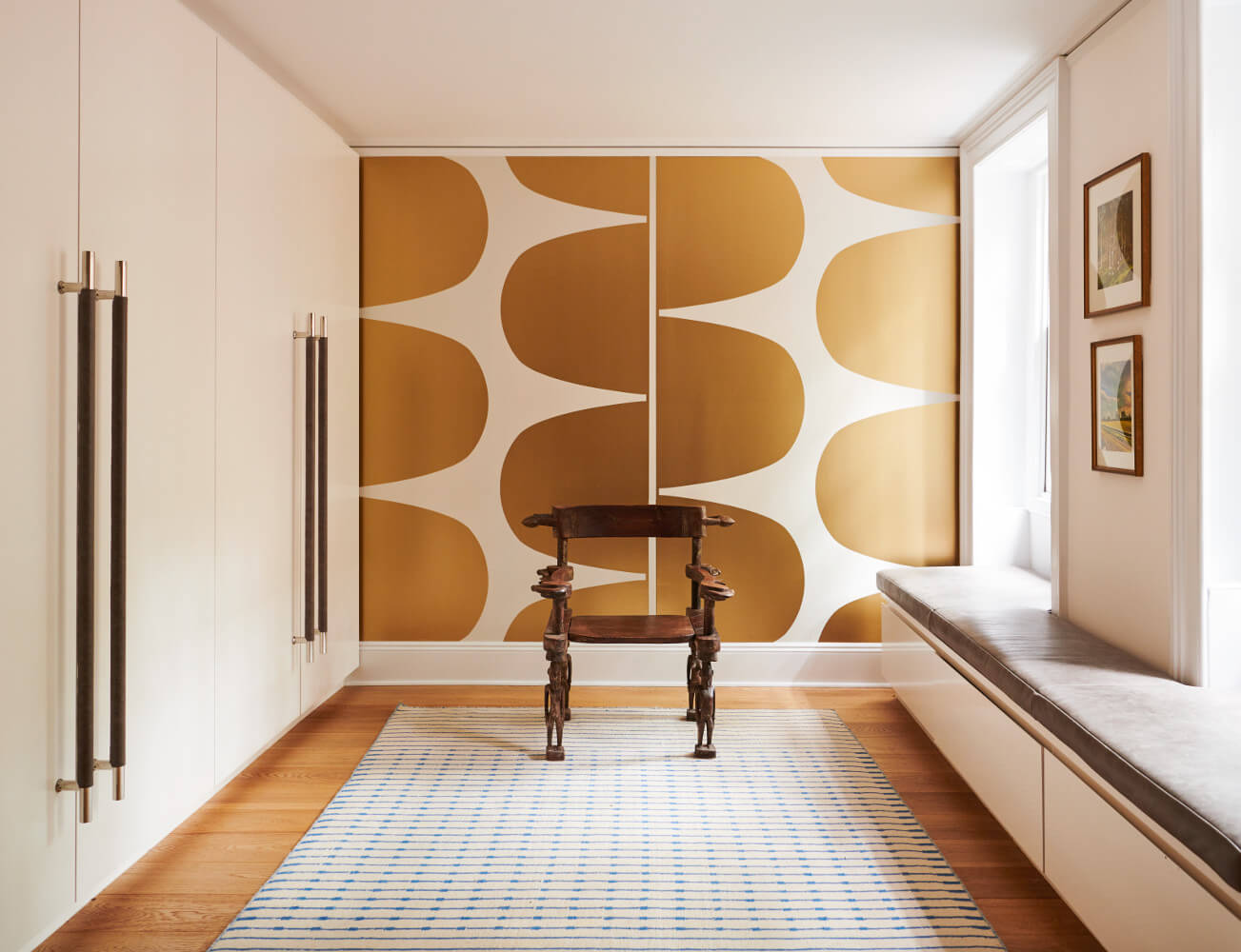 The mudroom combines an over-scaled wallpaper pattern with sleek built-ins.