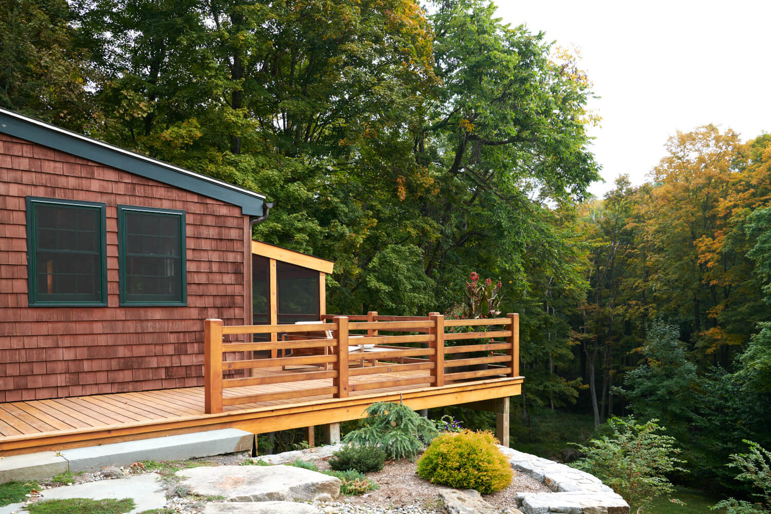 The enlarged deck and screened porch in the addition of this CT house.