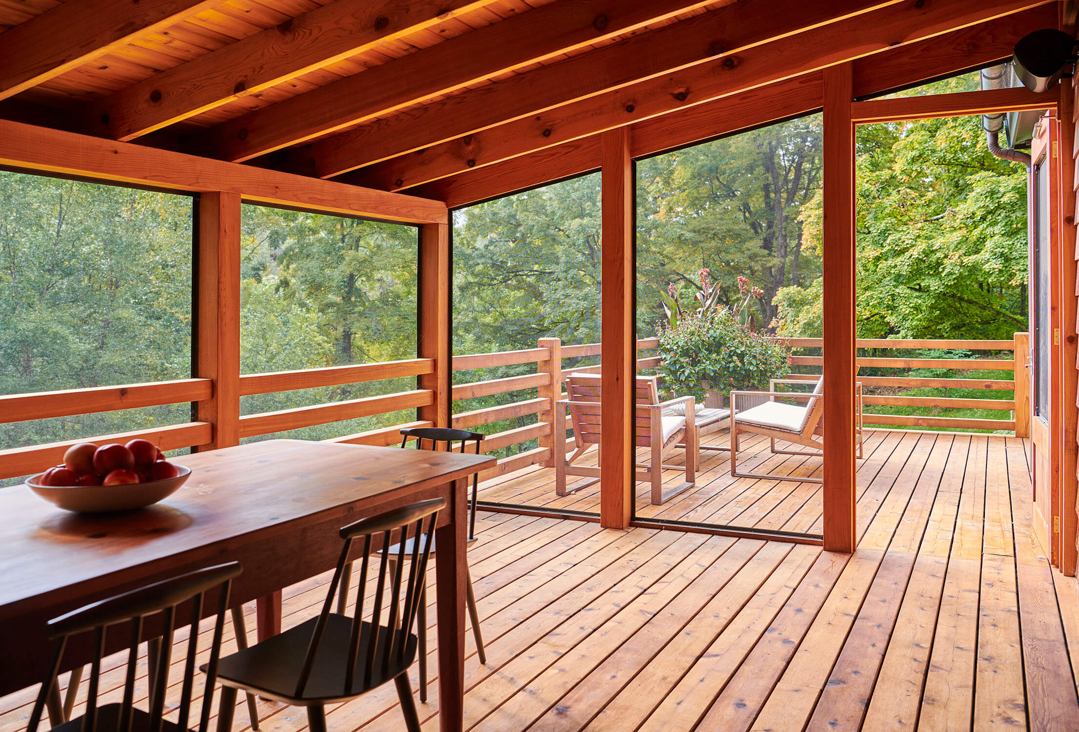 The enlarged deck and screened porch of our Connecticut house.
