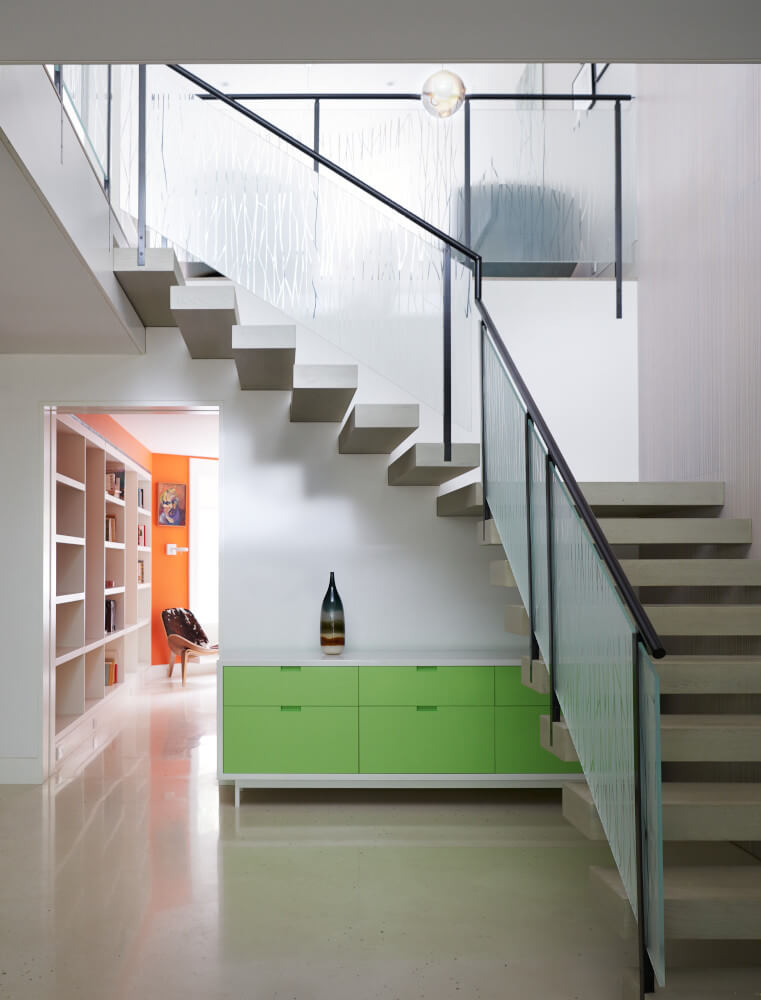 In this Park Slope addition, we relocated the main stair to a new opening in the middle of the first floor. Floating wood treads cantilever from a wall clad inbamboo plywood down to polished concrete floors.