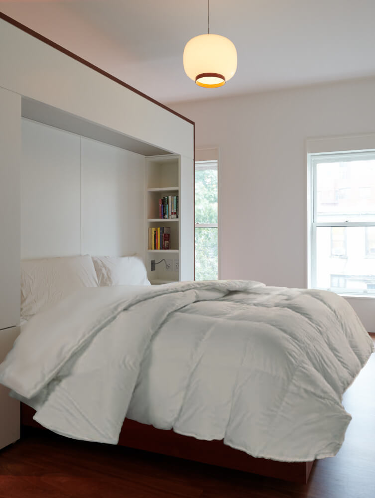 The parents' bedroom of this Park Slope addition is separated from the bathing by a free-floating headboard wall.