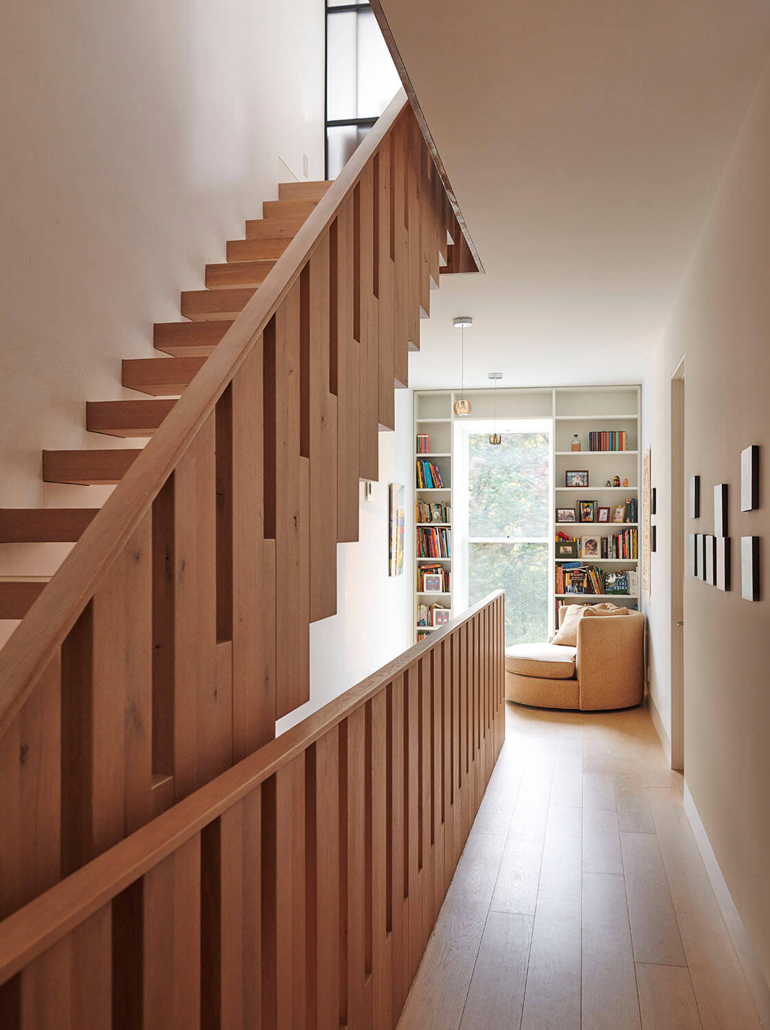 In this Park Slope addition, solid oak stair treads first cantilever from the wall, then turn up 90° to form a balustrade.
