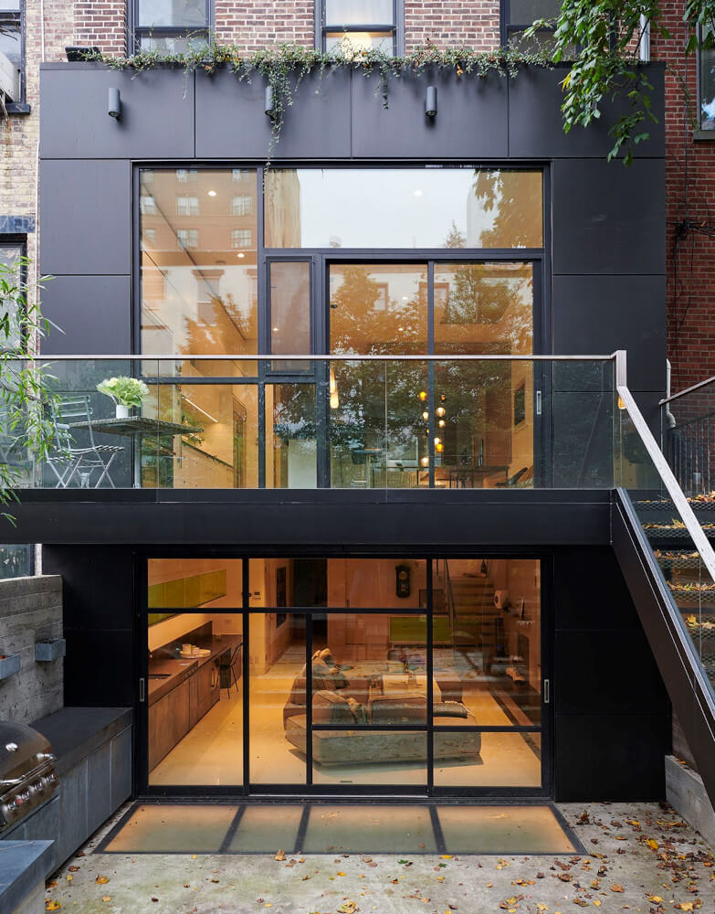 The rear extension of this Park Slope addition is clad in black metal panels.
